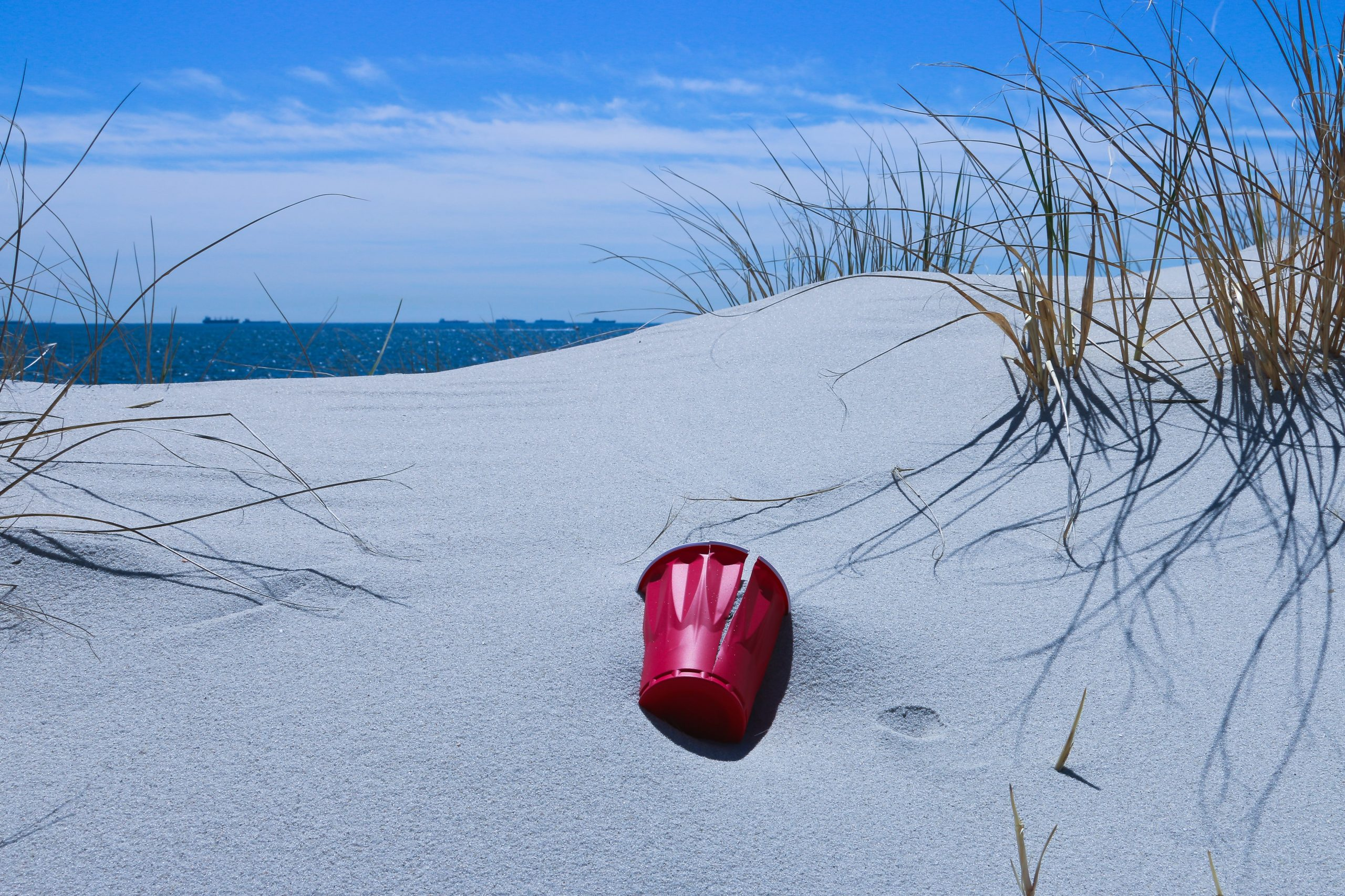 sand dune and red bucket